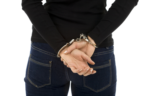 http://www.dreamstime.com/royalty-free-stock-image-woman-hands-backs-handcuffs-image12705706