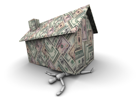 http://www.dreamstime.com/royalty-free-stock-images-person-crushed-under-house-made-money-image19447949