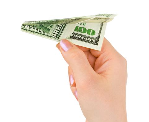 http://www.dreamstime.com/stock-photos-hand-money-plane-image12991653